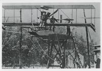 LIEUTENANT THEODORE G. ELLYSON ON THE FIRST AVIATION CATAPULT DEVICE