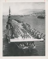 AIRCRAFT CARRIER WITH AIRCRAFT PLANES AND NAVY OFFICIALS